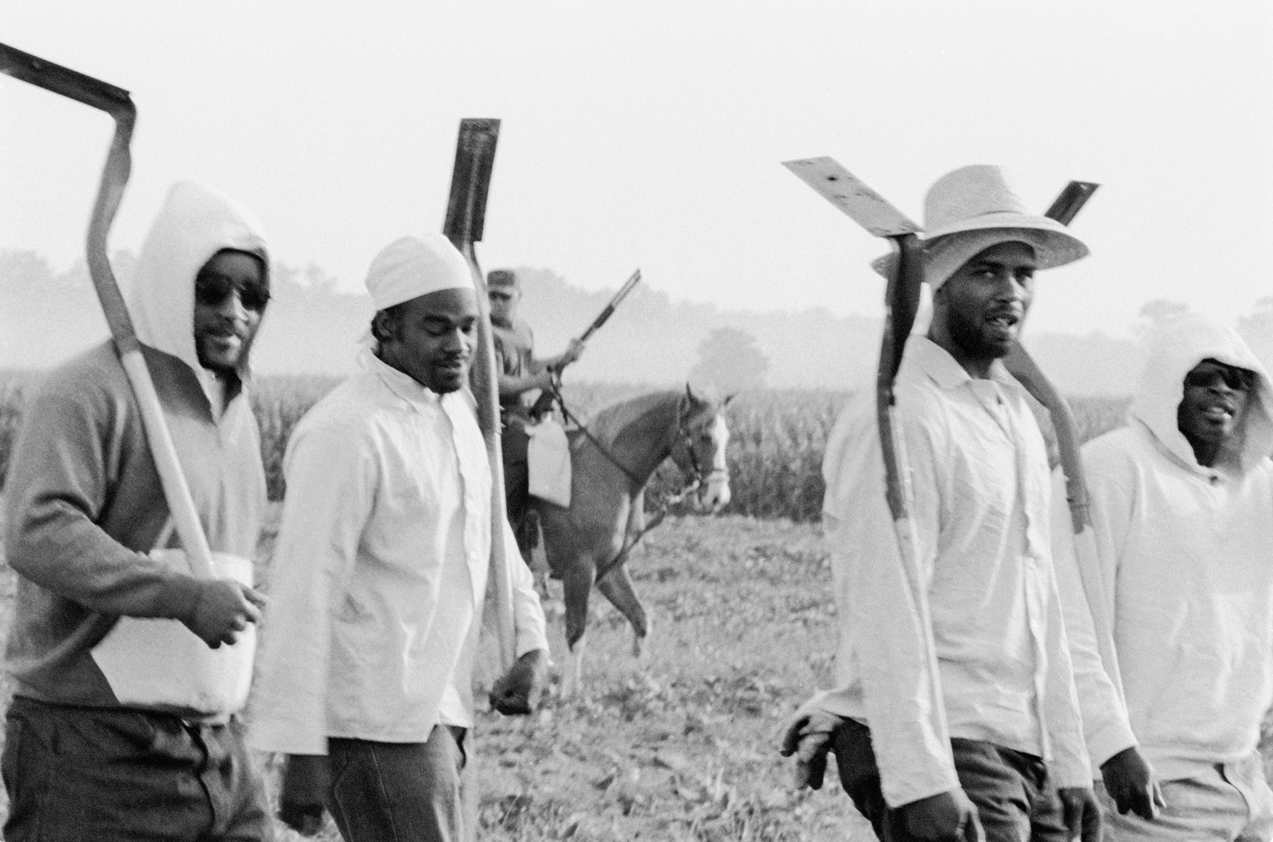 Chandra McCormick, Men going to work in the fields of Angola, 2004. Courtesy the artist.