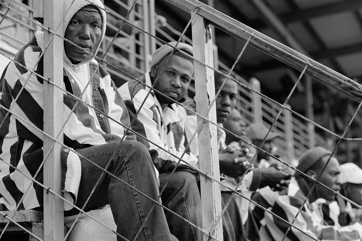 Chandra McCormick, Waiting for the Bull, Men Waiting to Participate in the Angola Rodeo, 2013. Archival pigment print. Courtesy of the artist.