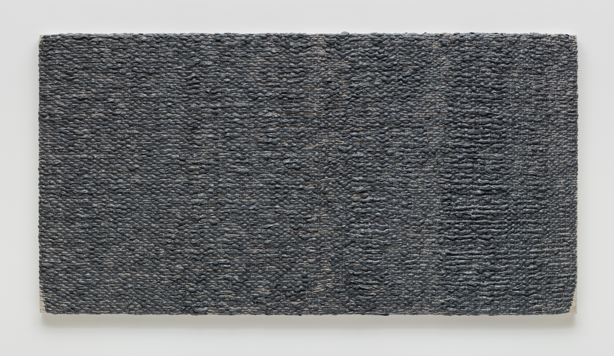 Analia Saban, Woven Solid as Warp, Horizontal (Gray) #1, 2017.  Acrylic paint woven through linen canvas on panel.  202.6 x 106 x 6.4 cm. Photo by Brian Forrest.