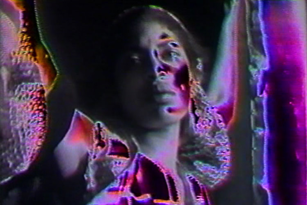 Still from Barbara McCullough's Shopping Bag Spirits and Freeway Fetishes: Reflections on Ritual Space, 1981. Digital video, color.