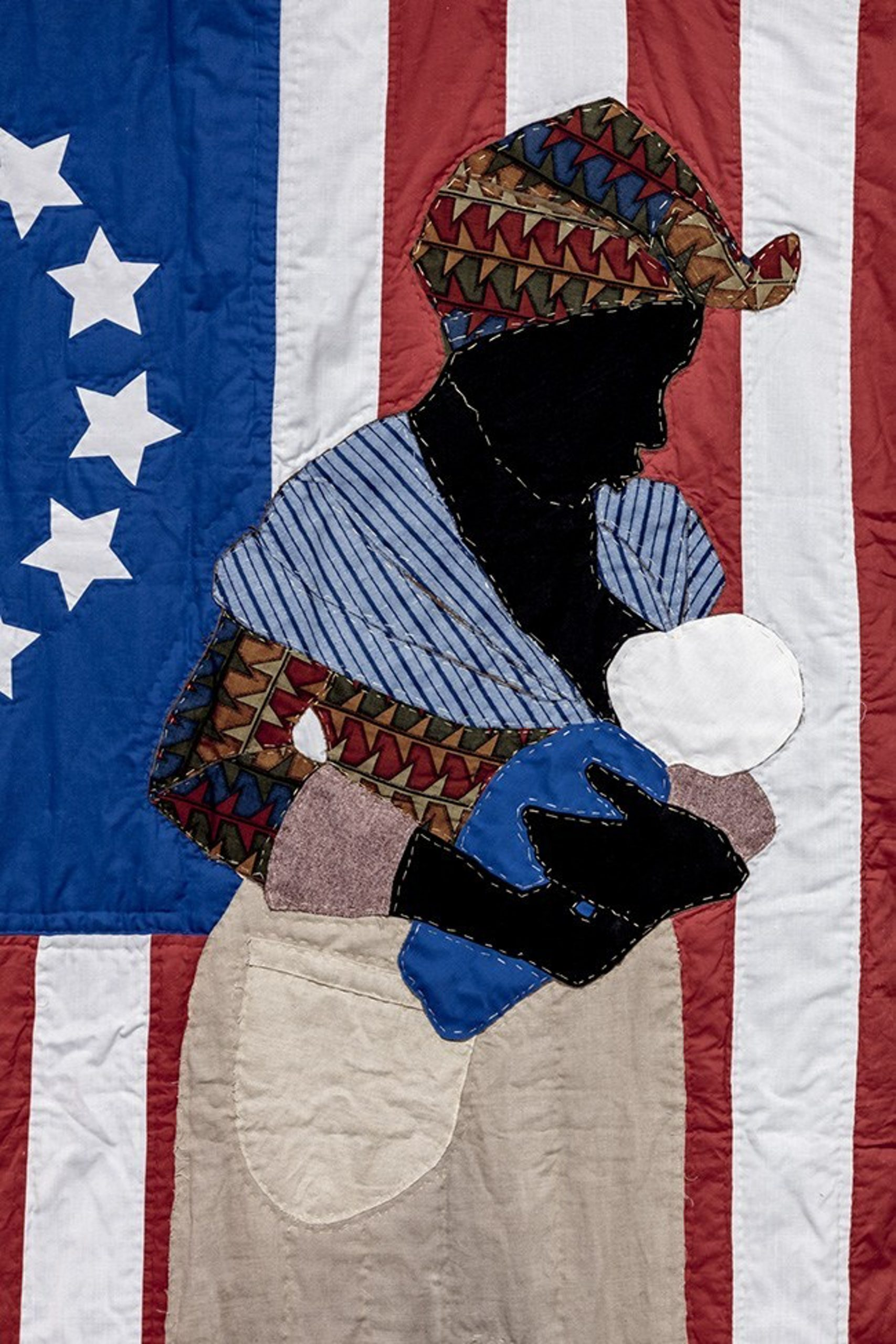 Stephen Towns, Birth of a Nation (detail) (2014). Natural and synthetic fabric, polyester and cotton thread, metallic thread, Thermoweb, cotton/polyester blend batting, coffee and tea stain, and acrylic paint, 90 x 66 inches. Image courtesy of the artist and Art+ Practice. Photo: Joshua White.