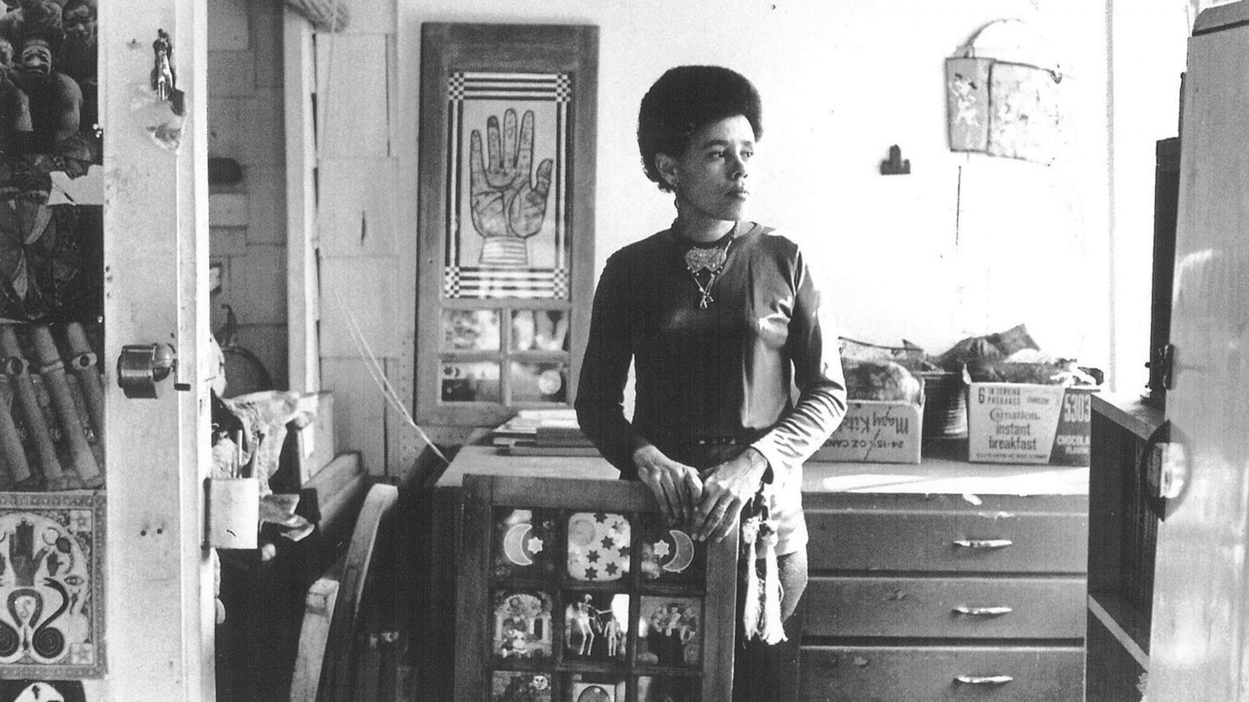 Portrait of Betye Saar in her Laurel Canyon Studio, 1970. Standing with Black Girl's Window, 1969, which was acquired by MOMA in 2013. (Bob Nakamura / Roberts Projects, Los Angeles)