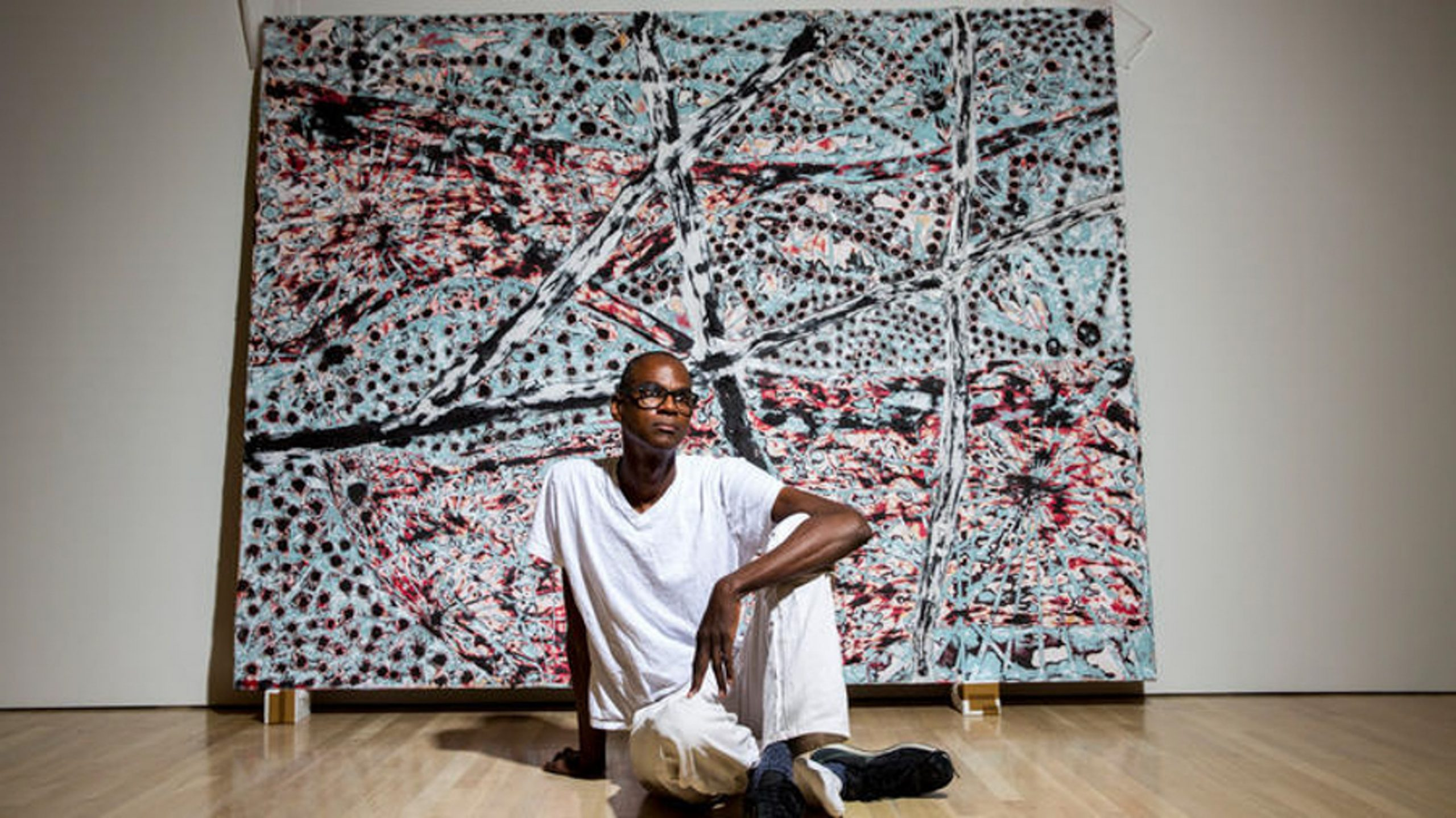 Los Angeles-born artist Mark Bradford in front of The Next Hot Line, 2015. (Jay L. Clendenin / Los Angeles Times)