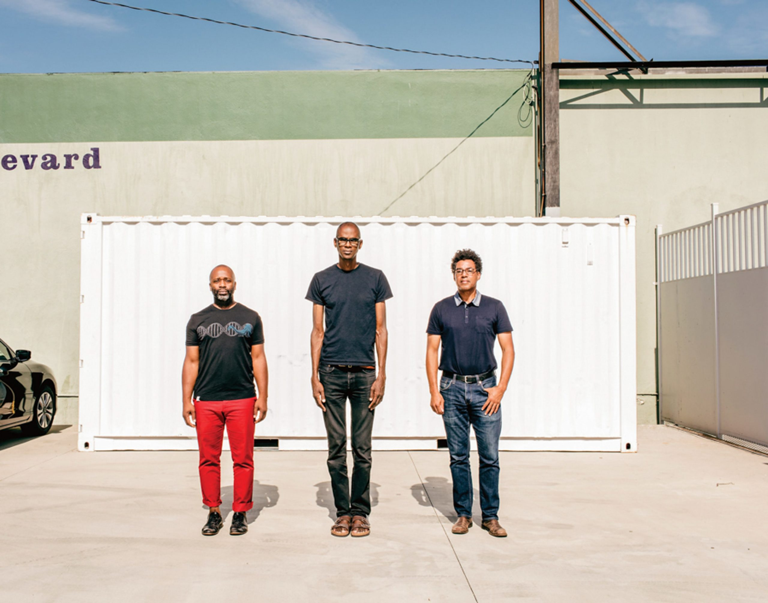 The artists (from left) Theaster Gates, Mark Bradford and Rick Lowe in Los Angeles outside one of Bradford's Art + Practice buildings, which serves as both a gallery and a social services agency. Photo by Stefan Ruiz.