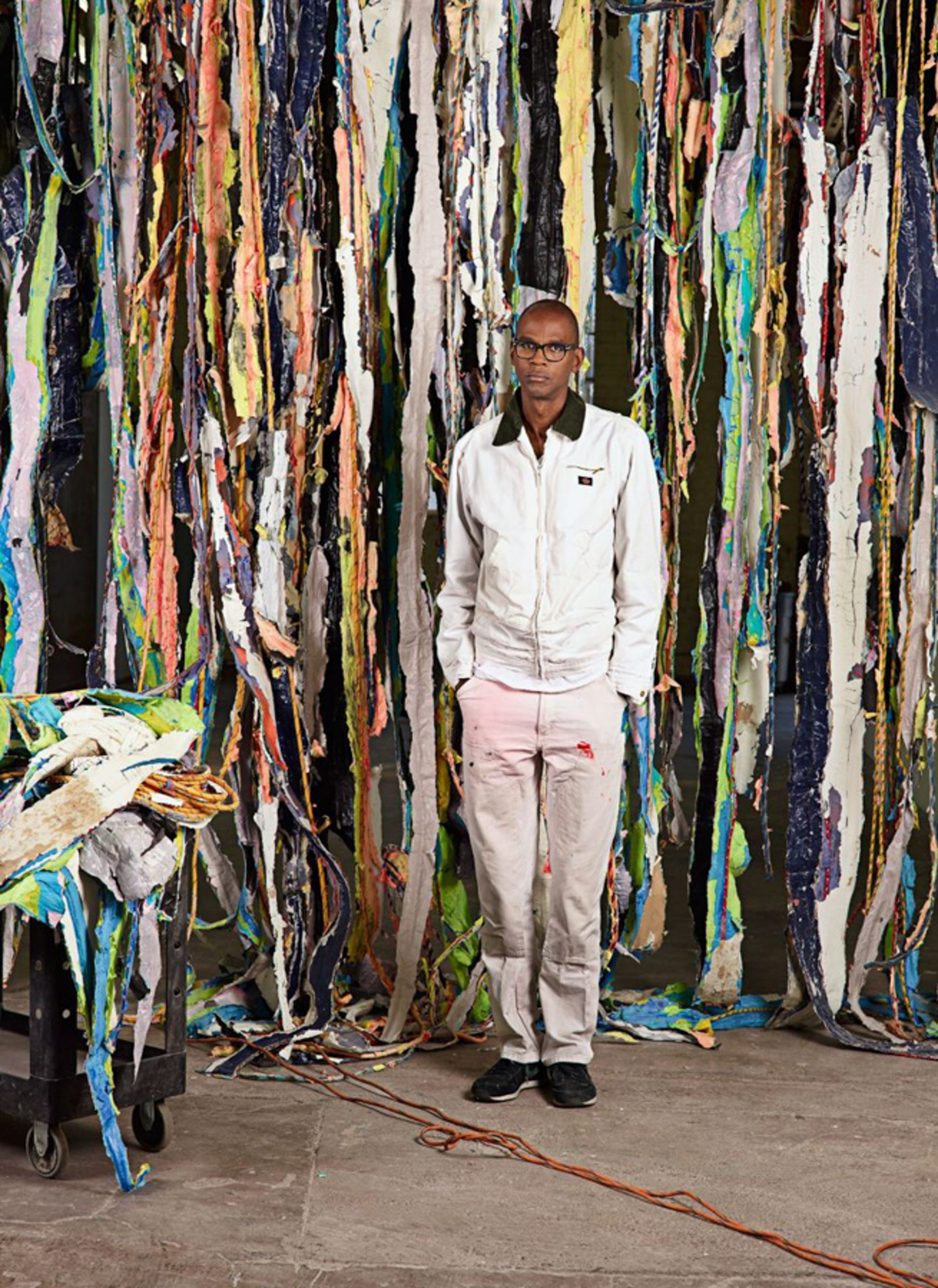 Bradford with a work in progress at his studio, in South Los Angeles. Photography by Catherine Opie/Regen Projects.
