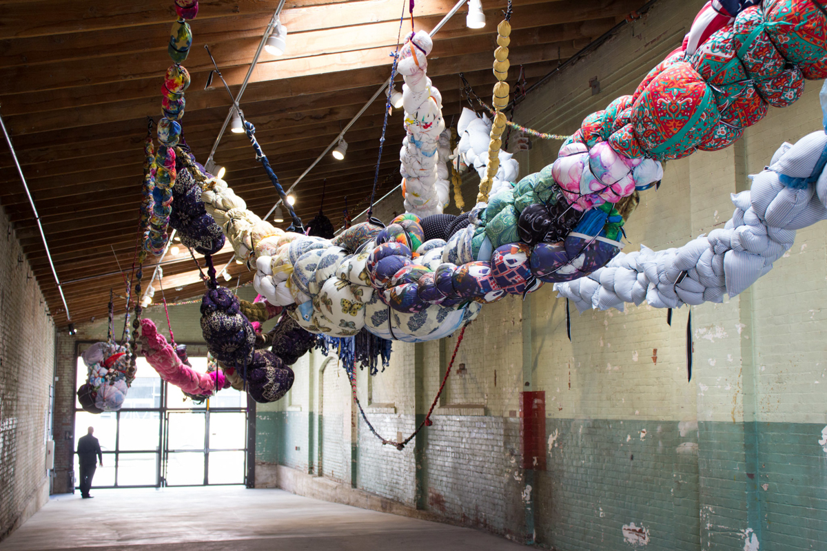 Shinique Smith, Forgiving Strands, 2014-2016. Sculptural Installation - Clothing, Fabric, ribbon, rope, found objects, approximately 80 x 20 x 15 feet. Installation view: Hauser&Wirth, Los Angeles, 2016.